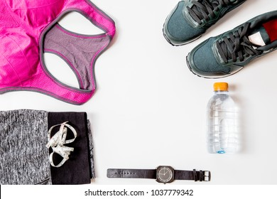 Women's Exercise Dress Red shirt and black pantsUse to wear a workout. Drinking water, headphones and Clock uses timerPlaced on a white background.