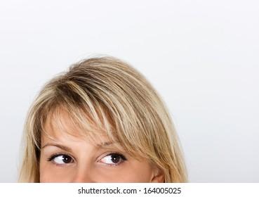 women's eyes peek out from behind framework