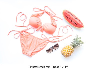 Women's fashion accessories items with sweet swimsuit bikini and tropical fruits on white background, summer and holiday concept
