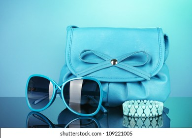 Women's fashion accessories on bright colorful background