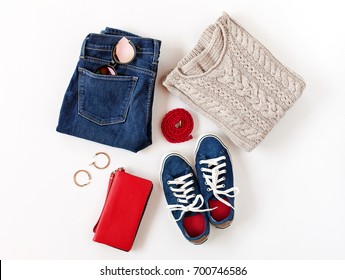 Women's fashion clothes and accessories in blue and red colors isolated on white background. Flat lay, top view.