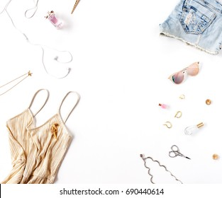 Women's fashion clothes and accessories isolated on white background. Flat lay, top view. Beauty blog concept.