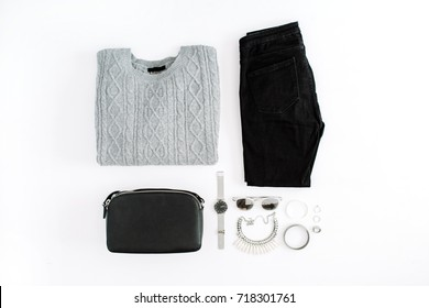 Women's fashion clothes and accessories on white background. Flat lay female styled look. Top view