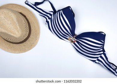 Women's fashion with sweet swimsuit bikini on white background. Travel vacation concept. Summer background. Beach fashion , summer concept. Road frame set. Flat lay, top view