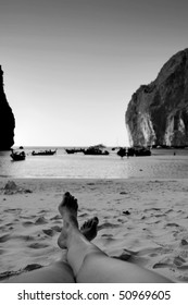 Women's feet on Maya Beach, Phi Phi, Thailand