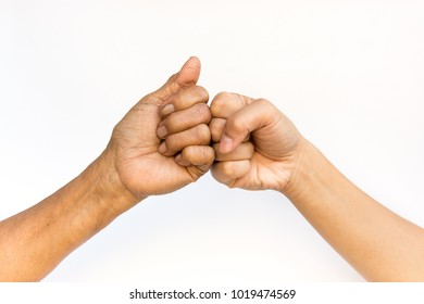 Women's fists of different generations touching each others in a cooperation gesture. Family/ cooperation/success concept.