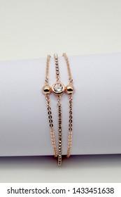 women's gold bracelet on whit background jewelry, gold bracelet with stones, women's jewelry, a girl with a bracelet on her arm, a bracelet with stones