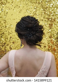 Women's hair back. A view of the woman's hair from the back. Fashion and hairdressing concept.