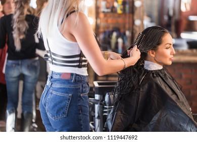 Women's hair salon. Beautiful brunette woman in Spa salon. Keratin restoration, latest trend, fresh idea, haircut picking, shorten tips concept