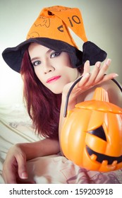Women's Halloween hat and pumpkin in concept halloween