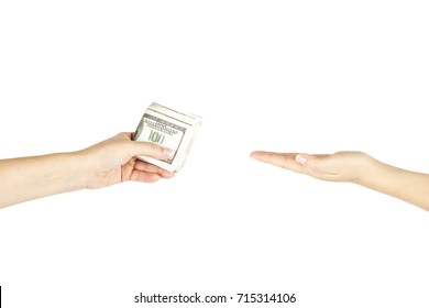 Women's hand is giving bunch of money another hand on white isolated background.