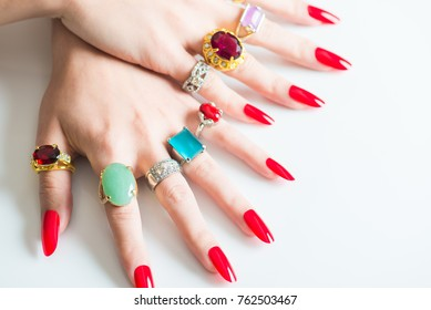 Women's hand with lots of  jewelry rings