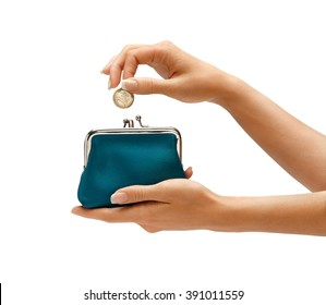 Womens hand throwing a coin one euro in the purse on white background. Business concept