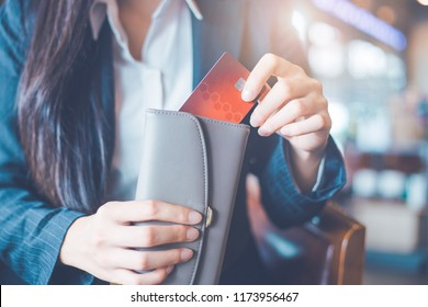 Women's hand Using a credit card, she pulled the card out of her wallet.