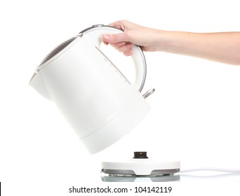 Womens hand and white electric kettle isolated on white