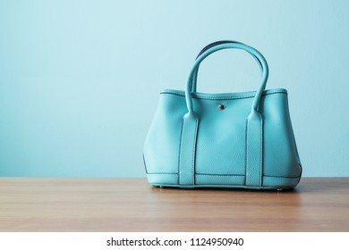 Women's handbag for ladies style or working women on wooden table