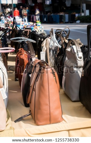 Women s handbags exposed for sale on a stall in the outdoor market. d18806f76641a