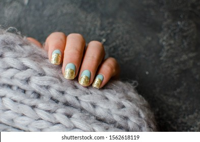 Women's hands with colorful pattern on the nails. Top view. Place for text. cozy winter style.