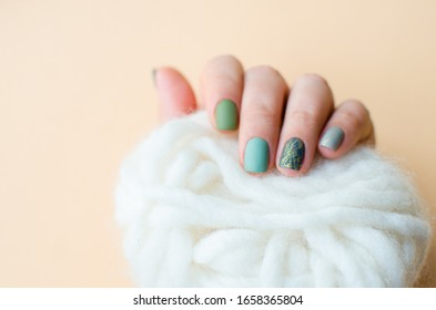 Women's hands with colorful pattern on the nails. 2020 colors trend. Top view. Place for text