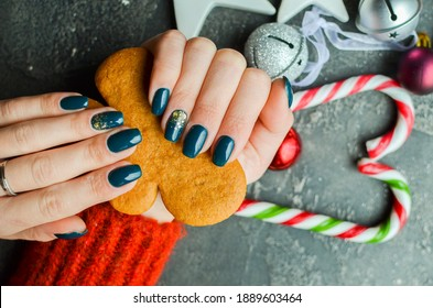 Women's hands with colorful pattern on the nails. 2021 colors trend. Top view. Place for text.