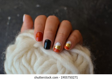 Women's hands with the colorful patterns on the nails. 2021 spring colors trend. Top view. Place for text