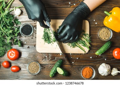 women's hands cut herbs, next to them are tomatoes, paprika, cucumbers
