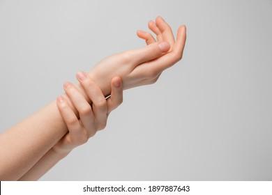 Women's hands get moist or show joint pain.