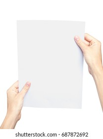 Women's hands holding a blank paper sheet, isolated on white. Clipping path included