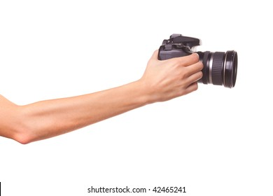 Women's hands holding the camera. Isolated on white.
