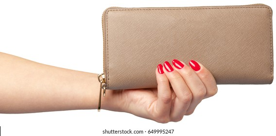 women's hands holding leather wallet