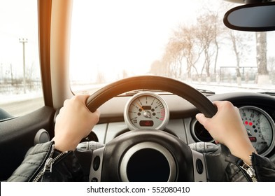 Women's hands on the wheel