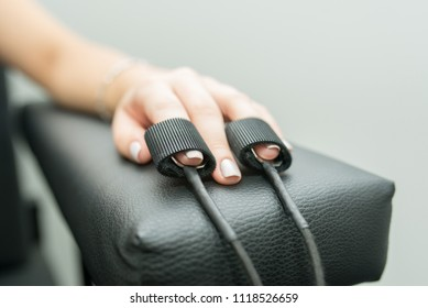 women's hands on which polygraph sensors are worn