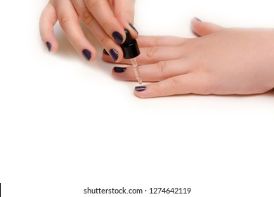 Women's hands. Woman paints her own nails