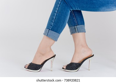 Women's high heels color black and gold in white background