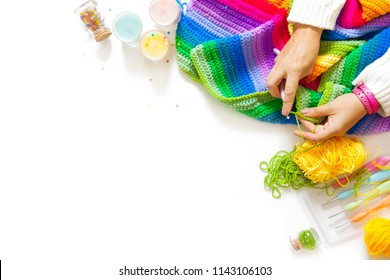 Women's hobby. Needlework and crocheting and knitting. Bright yarn. Concept of women's leisure.
