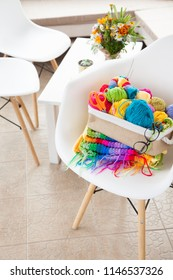 Women's hobby. Needlework and crocheting and knitting. Bright yarn in the basket. Concept of women's leisure. - Shutterstock ID 1146537326