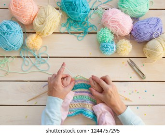 Women's hobby. Needlework and crocheting and knitting. Bright yarn. Concept of women's leisure.