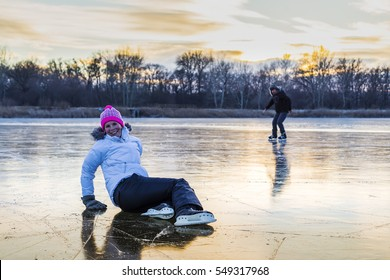 Women's ice skate on the lake.