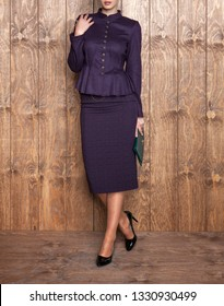 Women's jacket, blouse, coat, skirt and photomodel posing. Wooden floor. Fashion and design, luxury. Dark colored and patterned dress. Islamic fashion - Image