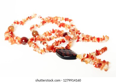 Women's jewelry on the neck of natural stones carnelian