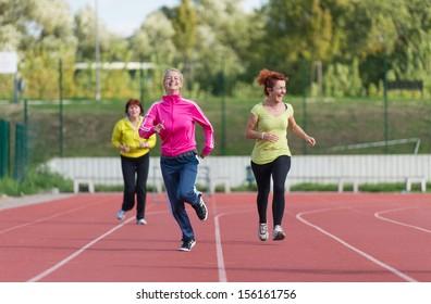 women's jogging on athletics track