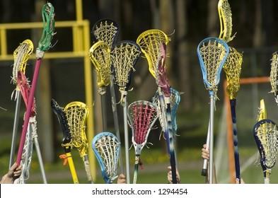 Women's Lacrosse sticks held high