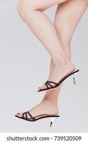 Women's Legs with High Heels Fashion in white background