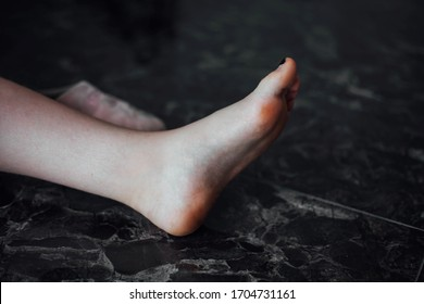 women's little leg against the background of the marble floor