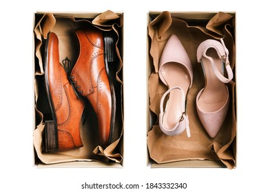 Womens and mens shoes in packaging isolated on white background. Classic and casual shoes. The concept of shopping and selling stylish things