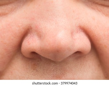 Women's nose on a white background