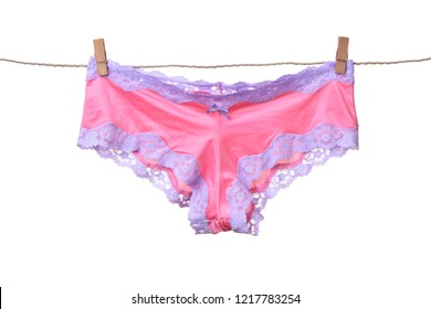 Women's panties hanging on rope isolated on white background
