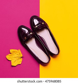 Women's patent leather Moccasins. Burgundy color. Trend Fall season fashion.