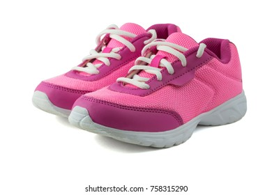 Womens pink sneakers with white laces isolated on white background. Beautiful and comfortable shoes for fitness training.