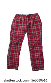 Women's plaid pajama pants and a red shirt, isolated on white, top view